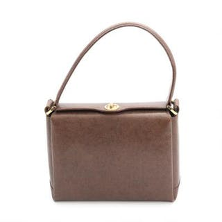 Gucci: A brown leather handbag with gold tone hardware