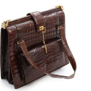 Aligator leather bag with gold tone hardware