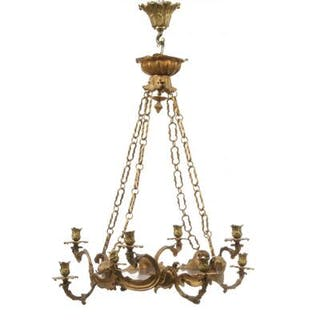 A Neo-Rococo seven-light gilt-bronze chandelier with red glass bottom plate