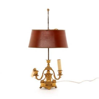 A bronze Bouillotte lamp with a red metal shade. C. 1900. H. 62 cm.