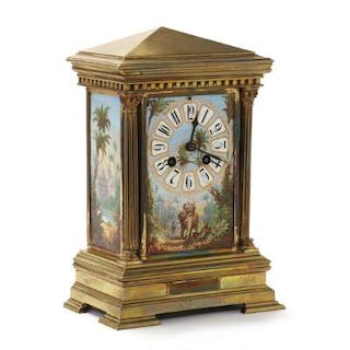 A striking mantel clock of bronze with porcelain plaques decorated in colours
