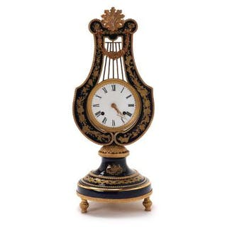 A French table clock in the shape of a lyre. 20th century. H. 48 cm. W. 20 cm.