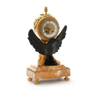 A Louis XVi style gilt and patinated bronze mantel clock
