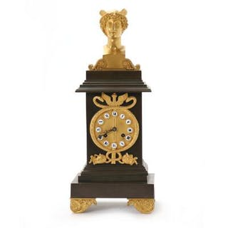 A French gilt and patinated bronze mantel clock