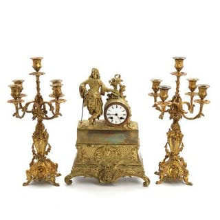 A French 19th century gilt bronze mantle clock ad a pair of candelabras