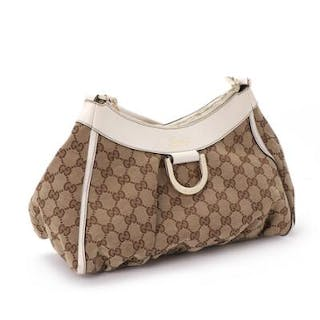 "Gucci: ""D-Ring Hobo"" a bag in beige monogram canvas with white leather details"