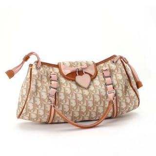 Christian Dior: A shoulderbag of beige monogram canvas...