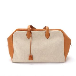 """Hermès: A """"Victoria"""" bag of beige canvas and brown calf skin"""