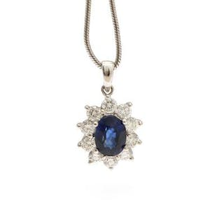 A sapphire and diamond pendant set with an oval-cut...