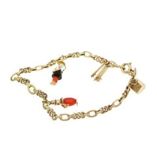 A charms bracelet set with four charms partly set with coral beads