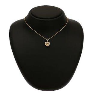 "Chopard: A ""Happy Diamonds"" heart shaped diamond pendant..."