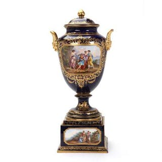 A tall c. 1900 lidded porcelain vase on a square base, mark of Vienna.