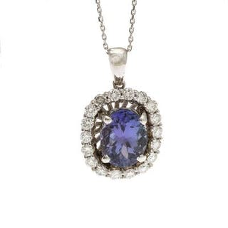 A tanzanite and diamond pendant set with an oval-cut...
