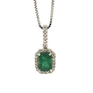An emerald and diamond pendant set with an emerald-cut...