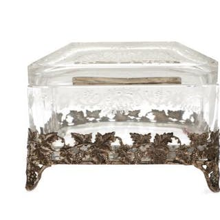 A clear ground glass and confectionery sugar casket with silver mountings