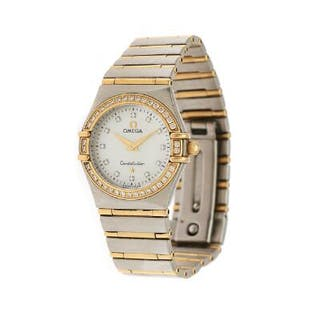 Omega: A lady's wristwatch of 18k gold and steel