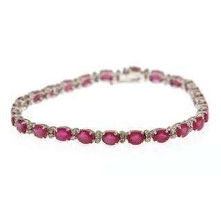 A ruby and diamond bracelet set with numerous rubies
