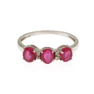 A ruby and diamond ring set with three oval-cut rubies...