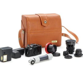 Pentax Auto 110 super mini camera with four lenses