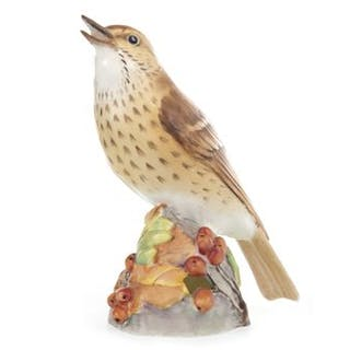 A ROYAL WORCESTER MODEL OF A THRUSH