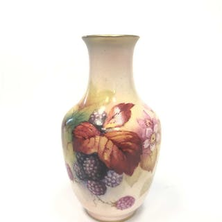 A ROYAL WORCESTER VASE BY KITTY BLAKE