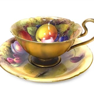 A ROYAL WORCESTER CUP AND SAUCER