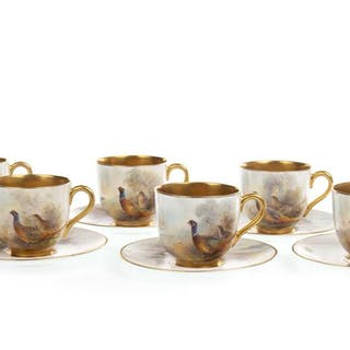 A SET OF ROYAL WORCESTER COFFEE CUPS AND SAUCERS