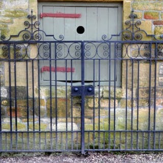 A pair of 19th century wrought iron parkland gates