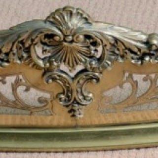 A 19th century brass serpentine fender