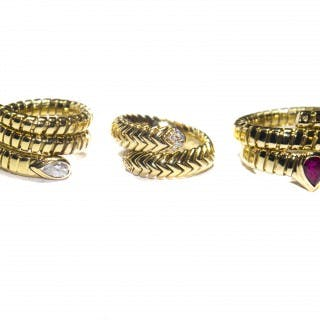 Three rings by Bvlgari in 18 carat gold and all part of their Tuba