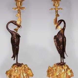 A Pair of mid 19th Century Bronze & Ormolu Candlesticks