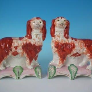 Pair Stafforshire King Charles spaniels on pink cushion bases