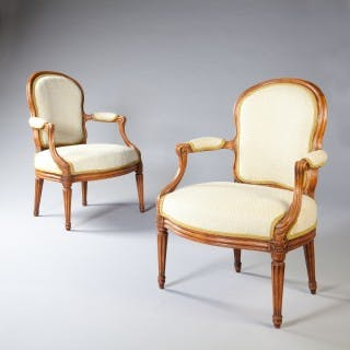 A FINE PAIR OF LOUIS XV TRANSITIONAL FAUTEUILS BY N S COURTOIS