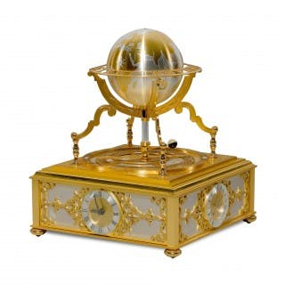 A silvered and gilt metal globe form astrolabium table clock by Hour Lavigne