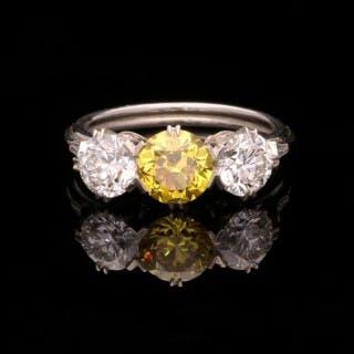An Elegant Yellow And White Diamond Three Stone Platinum Ring By Hancocks