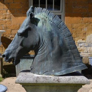 A verdigris cast bronze copy of the Roman horse head known as the
