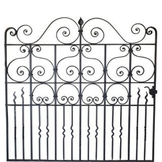 A large single wrought iron garden gate