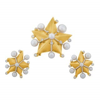 A Pearl and Diamond Gold Set by Fred Paris