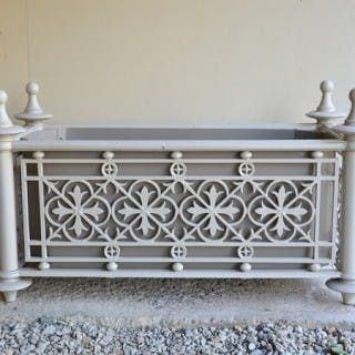 A pair of large cast iron Victorian planters