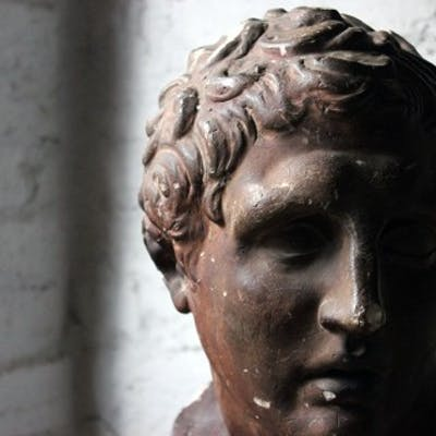 A Large & Decorative 19thC Classical Plaster Bust of The Sandal-Binding