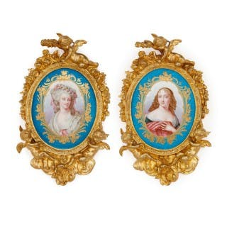 Pair of Sèvres style porcelain plaques in ormolu frames