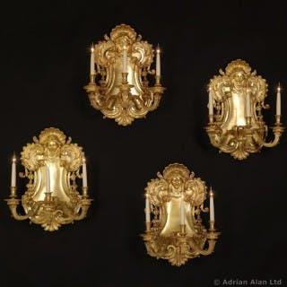 Set of Four Gilt-Bronze Three-Light Wall Appliques