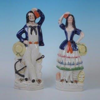Pair Staffordshire sailor & lass figures