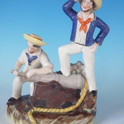 Staffordshire sailors & cannon figure group