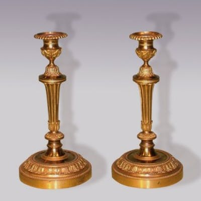 A Pair of mid-19th Century Louis XVI style ormolu Candlesticks.