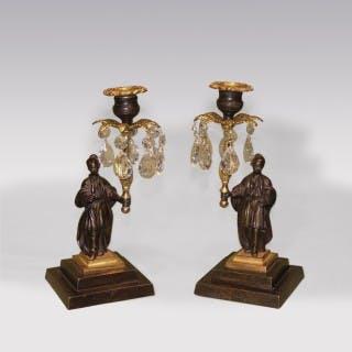 A Pair of early 19th Century Chinamen bronze & ormolu Lustre Candlesticks.