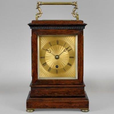 A nineteenth century English travelling clock, by PAYNE, 163 Bond