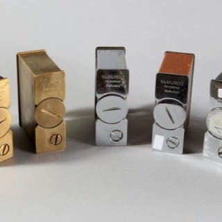 A COLLECTION OF MCMURDO TABLE LIGHTERS