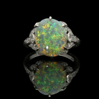 Hancocks White Opal Ring set in Platinum with Diamond Shoulders and