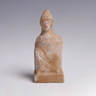 A Greek Terracotta of a Seated Man